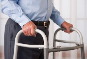 Getty_RF_Photo_of_stroke_patient_with_walker_boots_revised_2